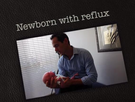 newborn with reflux